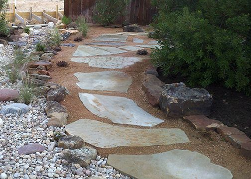 Flagstone set in crushed granite (could use 1 stepper in front of shed door or along path to steps or lawn)