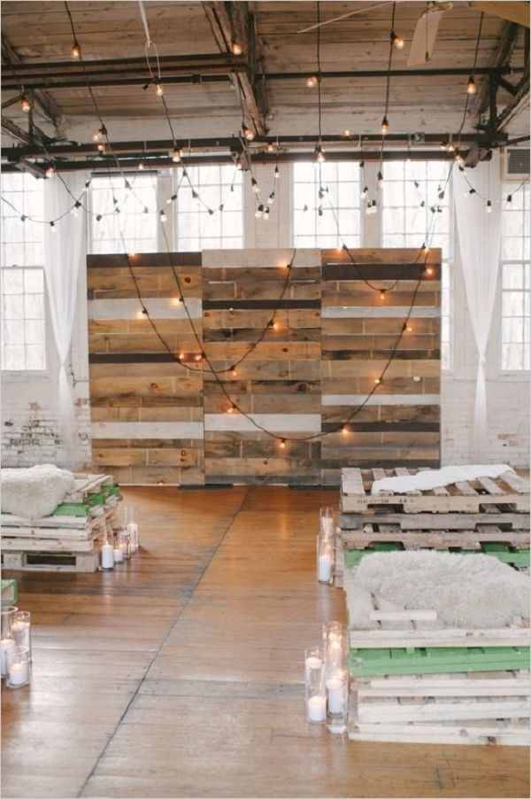 industrial wedding decor ideas with pallets and hanging lightin