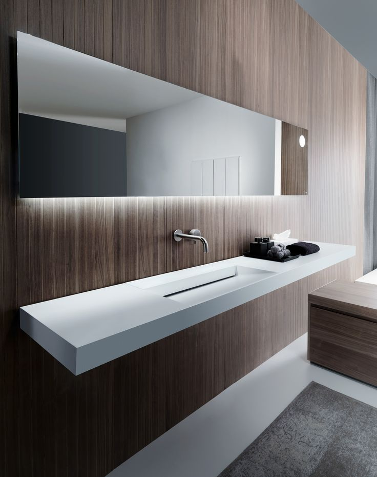 The essence of design as silent refinement. Top with ARC integrated washbasin in Cristalplant Biobased and straight edges mirror with OLED side lighting and LED lighting for the washbasin top. Follow us on it.pinterest.com/falperdesign