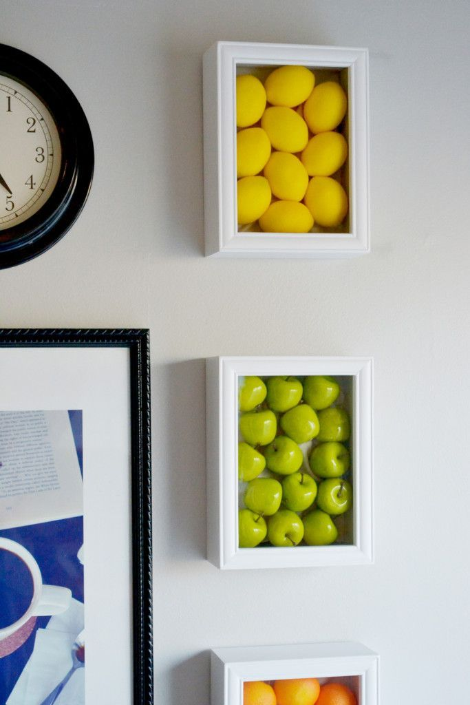 Wall art with large fake fruits