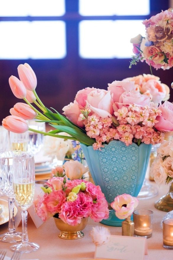 variety of pink flowers in an eggshell blue vase at a dinner party - spring flower centerpieces, floral arrangements, decor ideas