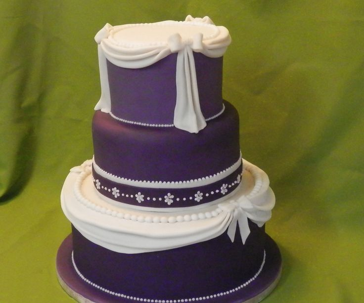 Purple Swag & Pearls #Wedding #Cake designed by Crumbs of Joy check out more designs from our recent Bridal Fayre #Beccles #Lowestoft #EastAngliaWeddings