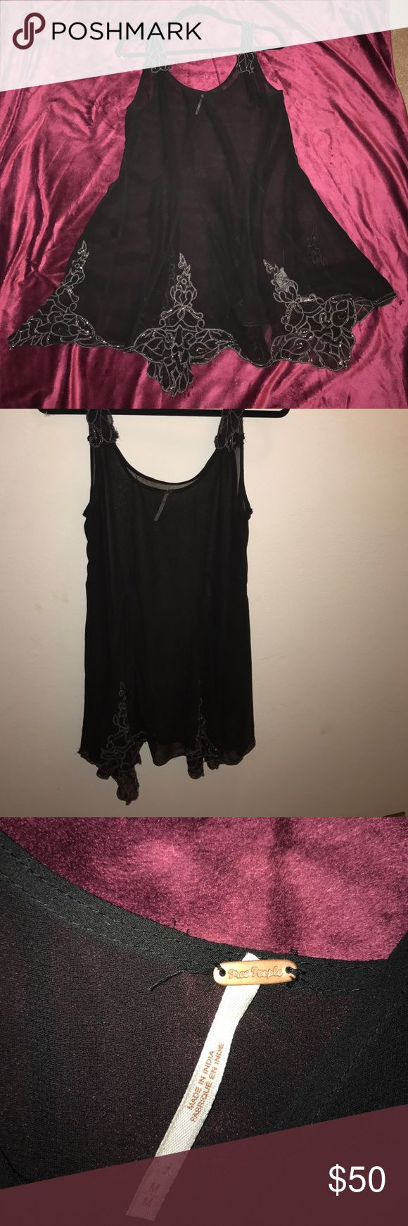 Free People Sheer Beaded Dress Worn once for a sorority formal. Black beaded sheer Free People dress is beautiful. Hate to part with it but I know someone else will enjoy it! Very sheer, a slip is definitely recommended if not required. Free People Dresses