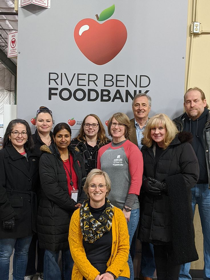 A group of eicc employees volunteered at the riverbend