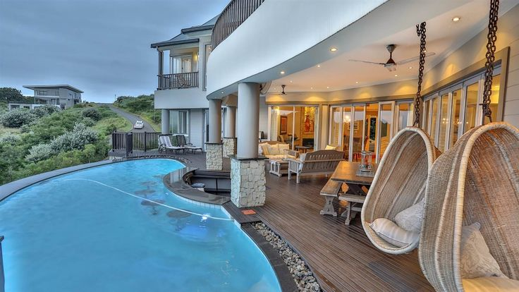 Step onto the veranda and enjoy the sun rise, the moon coming up over the ocean in total privacy. Overlooking a little dam to the ocean beyond, this home is spacious and private and access to the property is through a lovely planted panhandle.  #HomesInKwaZuluNatal #PropertyForSale #KwaZuluNatal #Ballito #Durban #ResidentialEstates