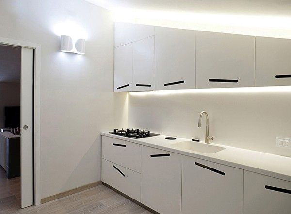 Designed by Studiovo, this sleek, contemporary apartment makes ample use of line and form for a look that is both striking and unusual. Sharply angled ceilings,