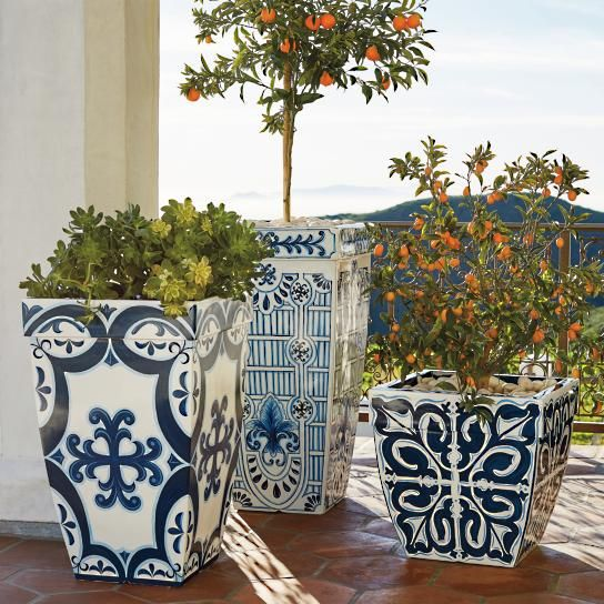 Inspired by handpainted Mediterranean tiles, our Santorini Planters evoke the beauty of a Grecian garden. Crafted of durable polyester resin, styrene and fiberglass, these gently tapered planters marry looks and longevity.   Designs inspired by Mediterranean tiles  Handpainted in vibrant, fade-resistant colors  Tapered box-style planter with lipped rim Crafted of polyester resin, styrene and fiberglass Planters hold 5-10 lbs. of soil, depending on size  Ideal for sunrooms, patios and garden…