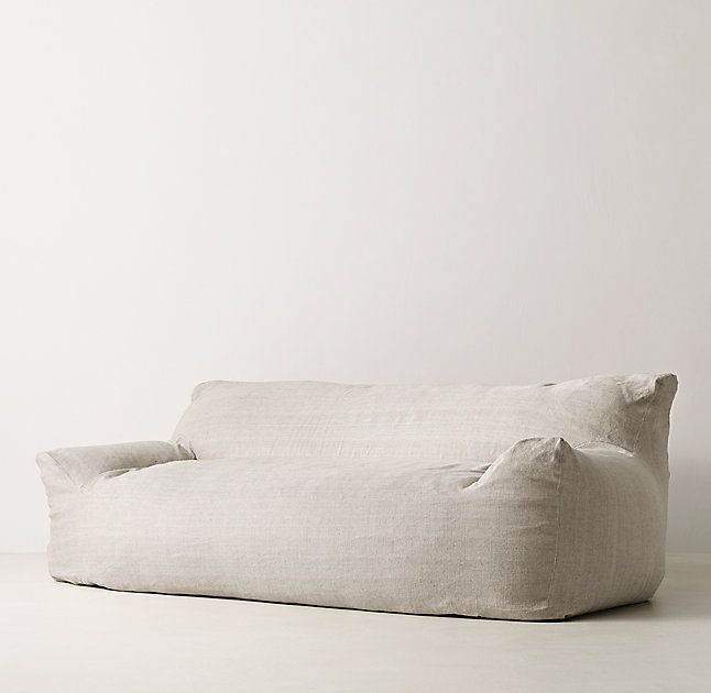 RH TEEN's Berlin Lounge Sofa:The next-generation bean bag. Our collection's body-conforming foam-and-bead insert ensures classic sink-in comfort, while the raised back and arm rests add an element of support to its relaxed silhouette.