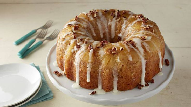 Classic Pineapple Upside-Down Cake meets Southern favorite Hummingbird Cake in this very impressive (but very doable) dessert. A sweet pineapple drizzle poked into the cake makes it extra moist and delicious.
