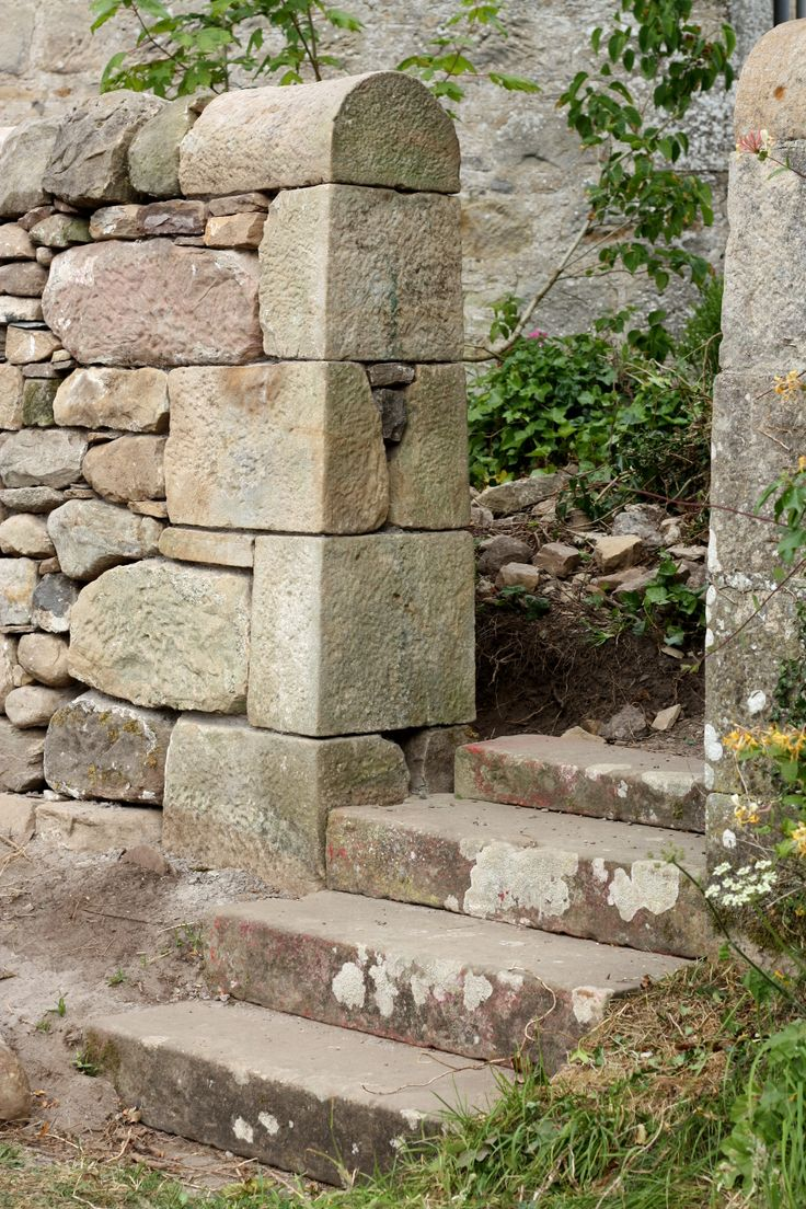 Mortared wall end and sandstone steps