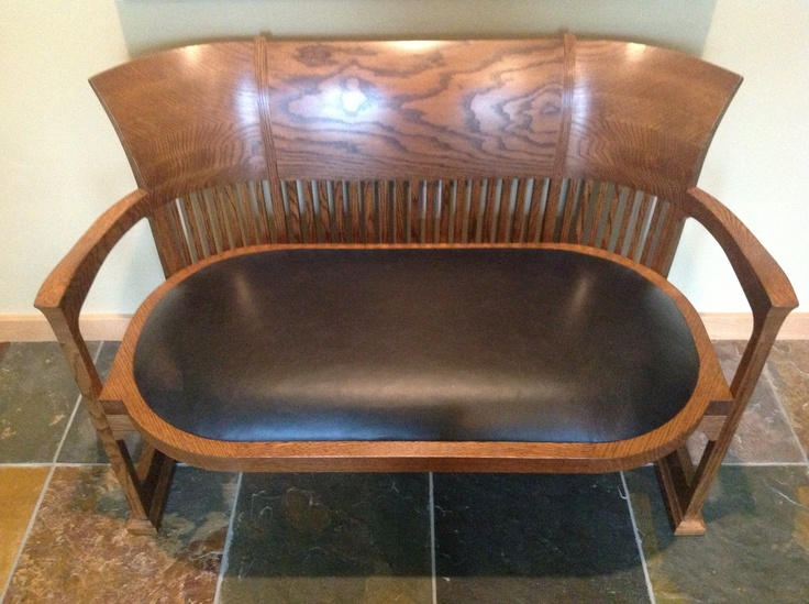 The Frank Lloyd Wright Barrel Chair - as a bench.  A barrel chair was bisected and converted to a bench by Randy and Julie Sahli of RJ Joinery