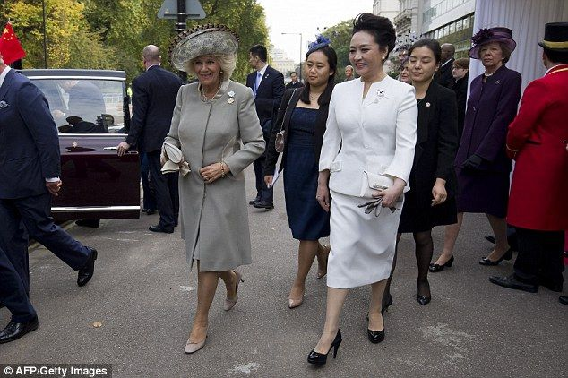 Camilla and Peng Liyuan smiled as they made their way to the royal car after leaving a central London hotel