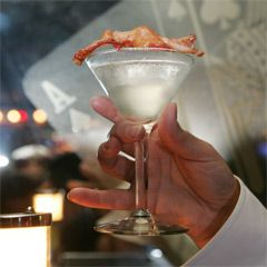 Very interesting! Bacon Martini. Bacon infused vodka, olive juice, tabasco bacon grease for the edge and of course, a slice of bacon.