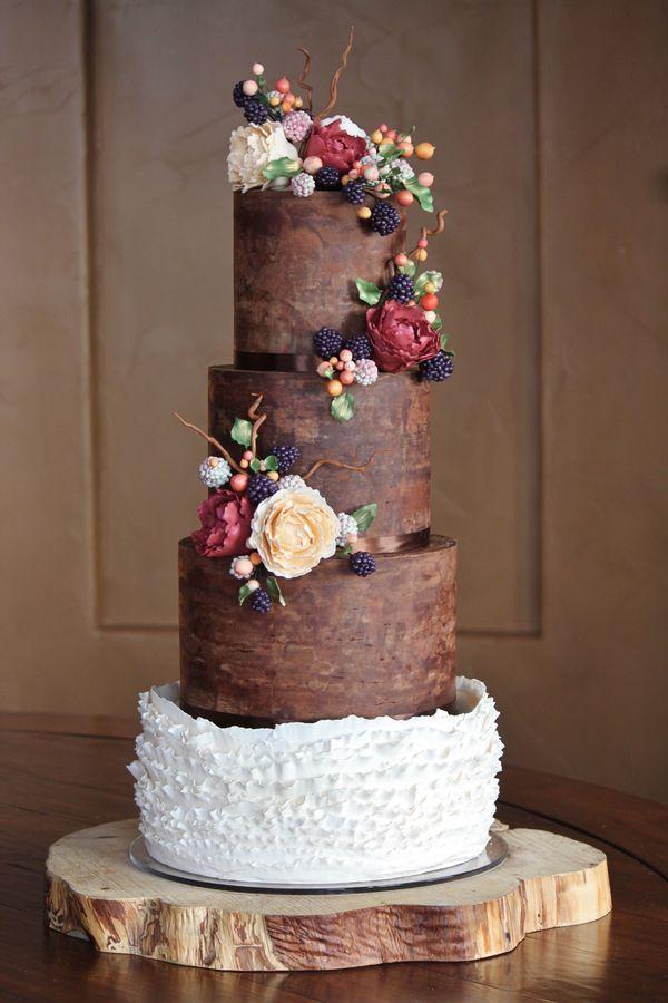 Rustic and organic wedding cake with chocolate ganache, ruffles, and handmade sugar blackberries, hypericum berries, peonies, leaves and twi...