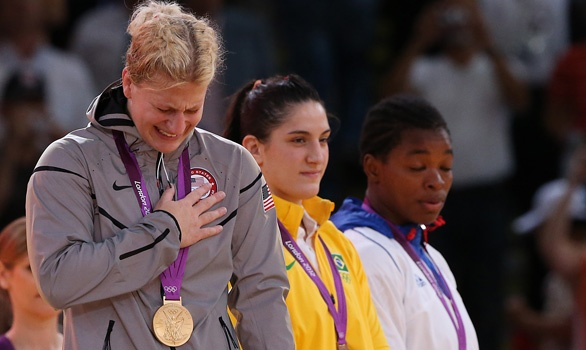 22-year-old Kayla Harrison wins gold in the Women's Judo 78-kilogram event, becoming America's first Olympic judo champion. She overcame sexual abuse to reach the medal stand.