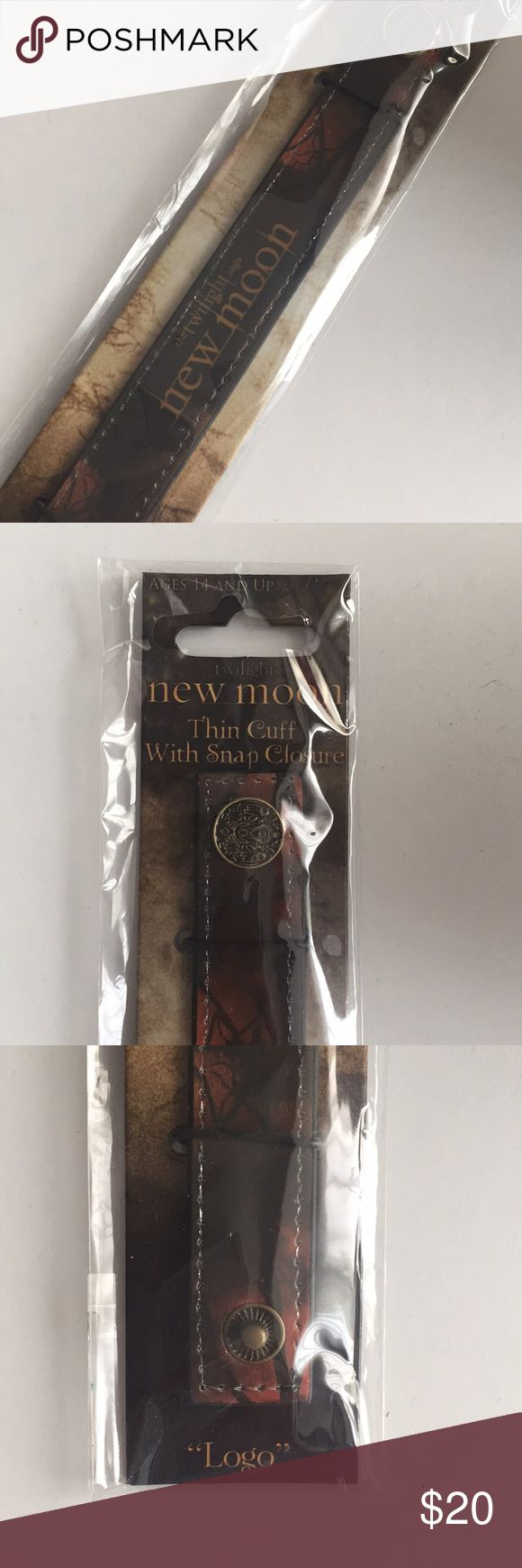 Twilight New Moon 🌚 Movie Logo Thin cuff bracelet Twilight New Moon movie logo 🌙Thin cuff with snap closure bracelet. Length: 7.5 inches. NWT & still in packaging! Great for the collector or movie fan! Non smoking Jewelry Bracelets