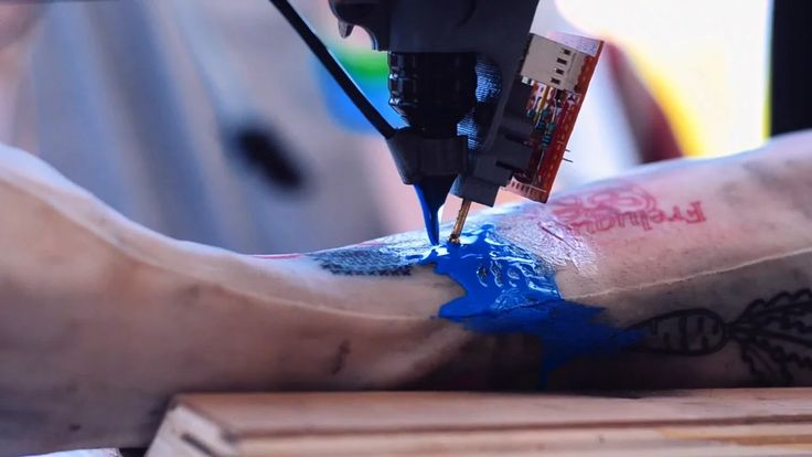 Future of tattoo's? 3D tattoo printer. I wonder what's going to come of this concept. It doesn't appear the needle goes as deep as what a standard tattoo gun does. I think I feel safer w/less error just having a good tattoist still doing my ink.  #Tattoos #Tattooprinter