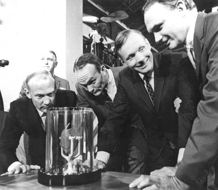 Apollo 11 astronauts, (left to right) Edwin E. Aldrin Jr., Lunar Module pilot; Michael Collins, Command Module pilot; and Neil A. Armstrong, commander, are showing a two-pound Moon rock to Frank Taylor, director of the Smithsonian Institute in Washington D.C. The rock was picked up from the Moon?s surface during the Extra Vehicular Activity (EVA) of Aldrin and Armstrong following man?s first Moon landing and was was presented to the Institute for display in the Art and Industries Building…