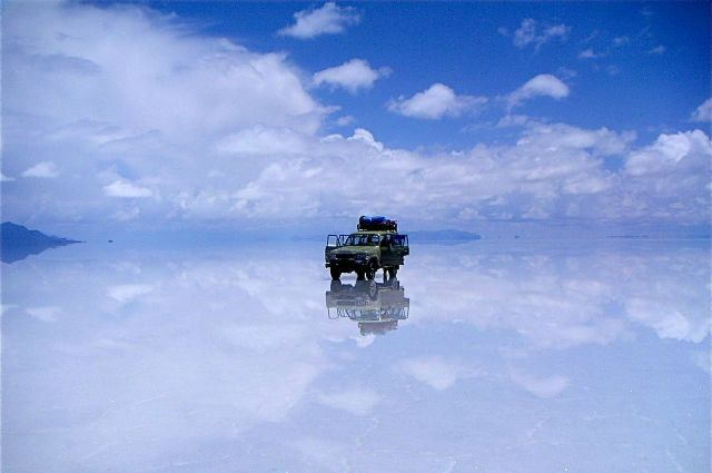 SALAR DE UYUNI, BOLIVIA /  Formed as a result of transformations between many prehistoric lakes, Salar de Uyuni is the world's largest salt flat. Because of the large, flat area and clear skies, it is often used for calibrating altimeters of Earth observation satellites. It also creates a dream-like reflection off of the crust.