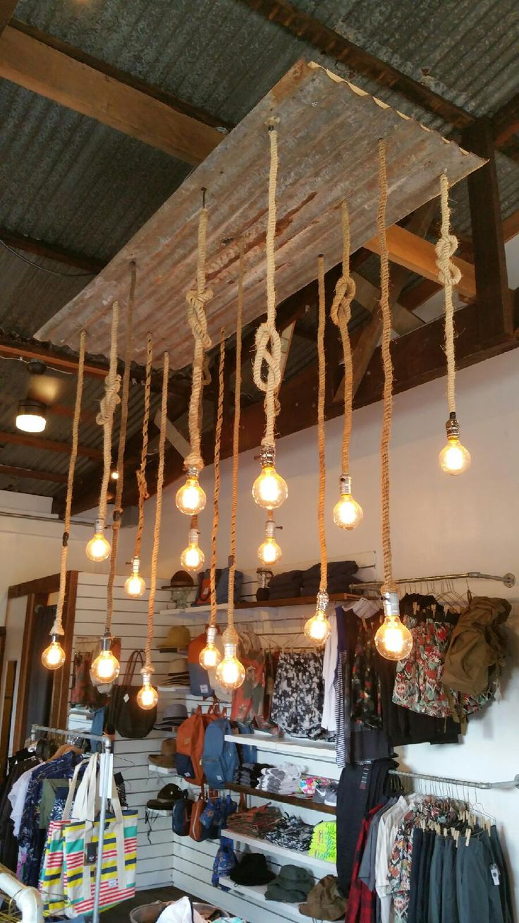 Corrugated metal chandelier w rope wrapped cords. Only at Micanohome.com RENO- We Make Things.