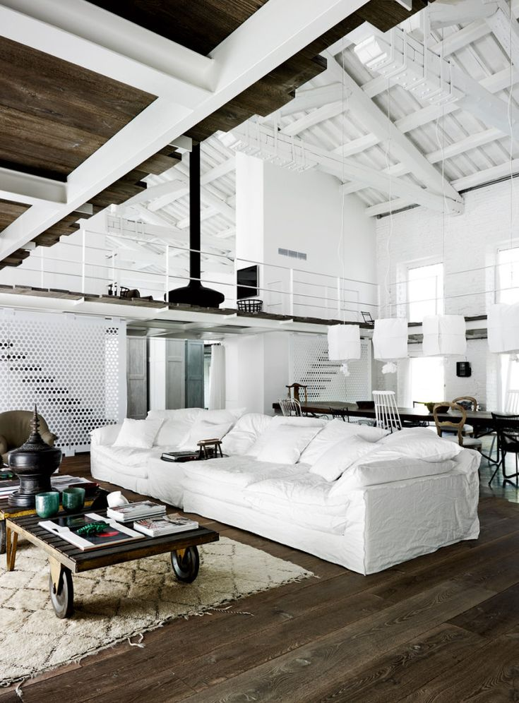 Warehouse living with exposed white rafters and vaulted ceiling