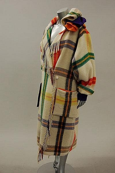 * Jean Charles de Castelbajac tartan coat, 1980s, of ivory wool banded in brilliant colours, purple cuffs and layered collar, fringed front borders