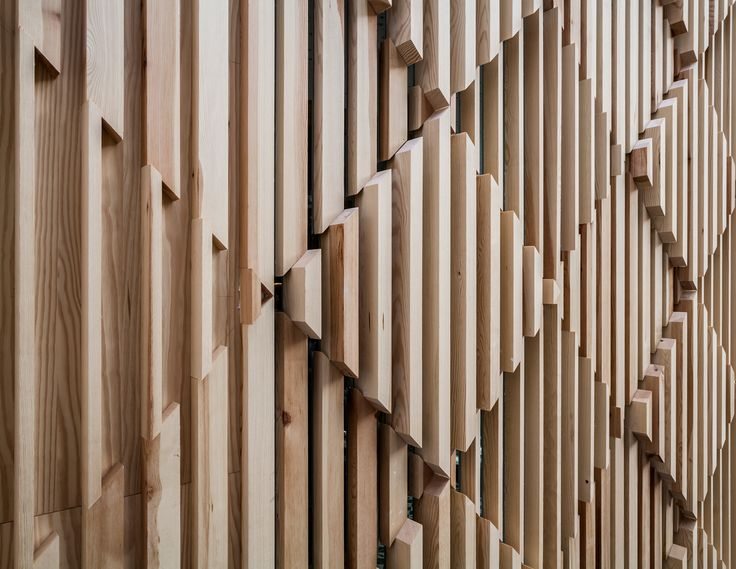 A Modern Cheese Bar in Barcelona by estudi{H}ac /// Facade made up of wooden pieces that form a three-dimensional diamond pattern.