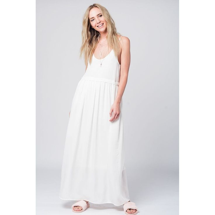 Vendor: Q2 StoreType: Women - Apparel - Dresses - Day to NightPrice: 55.00  Lightweigt maxi dress in white with a flattering empire line and a cami top effect with a round neckline it is perfect for summer days. Color: White  Material: 100% Polyester Lining: 100% Polyester  Item Fit / Dimensions: Relaxed fit  Made In: United States  Shipped From: United States  Lead Time: 1 - 2 Days  Cami strappy maxi dress in white