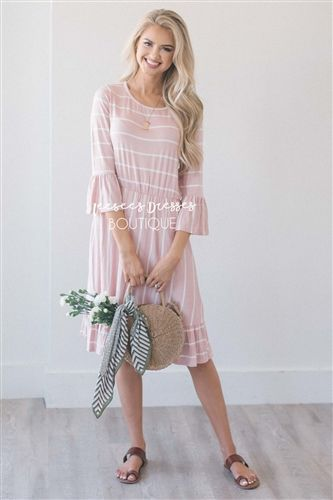 2a67e09903fd You can never go wrong with a cute striped dress! This light pink dress  features