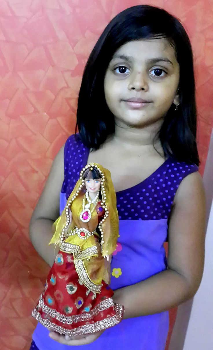 Cute girl with wedding doll