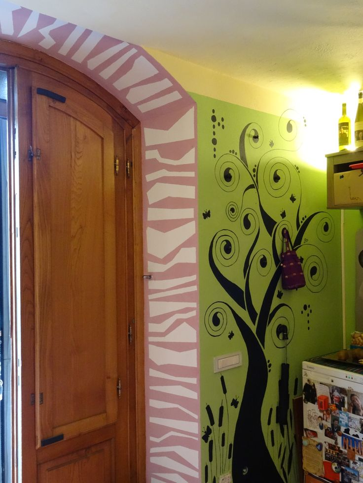 Wall painting around the door. Idea found over the internet and revisited by me.