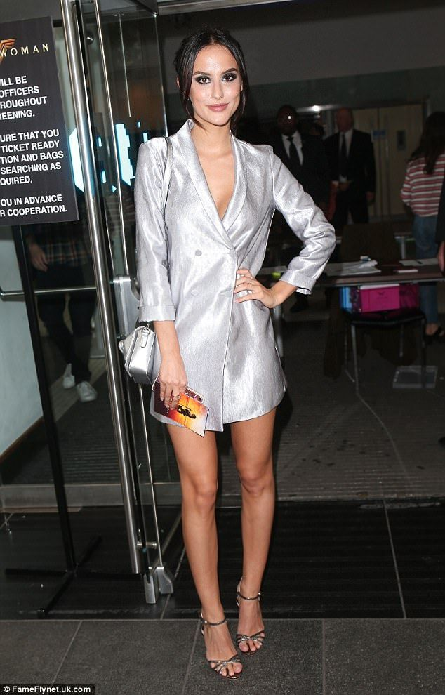 Chic: Lucy looked lovely in a futuristic ensemble, sporting a metallic blazer style dress that showed off a lot of leg