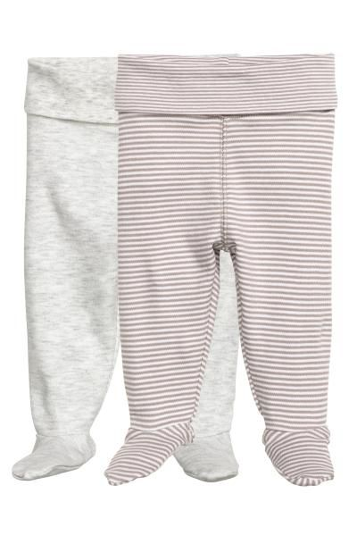 2-pack leggings with feet: CONSCIOUS. Leggings in soft organic cotton jersey with wide foldover ribbing at the waist and full feet.
