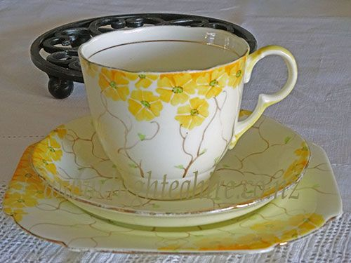 A beautiful hand painted cup saucer and plate for hire from highteahire.co.nz