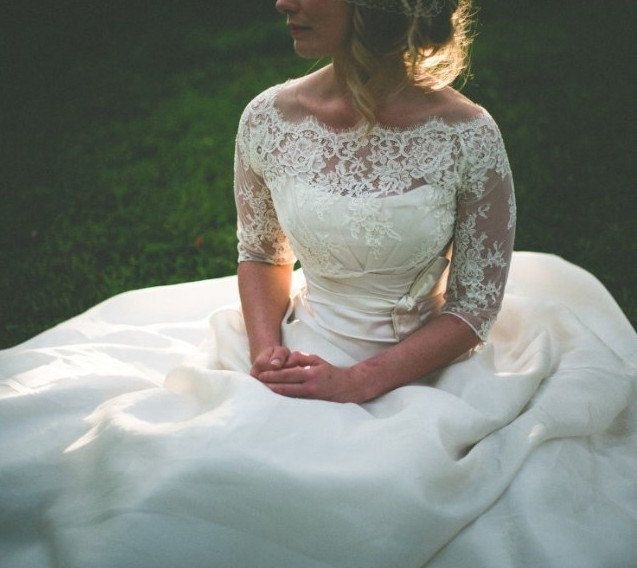 Love the lace and length of the sleeves