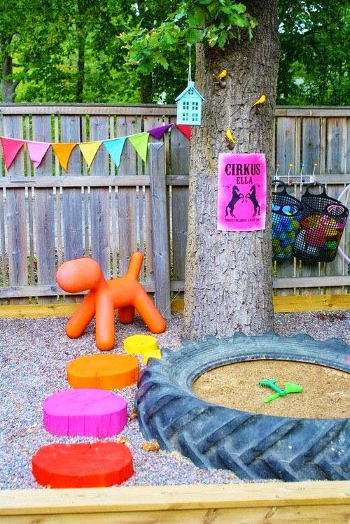 Creative outdoor space for kids - I love the idea of a tractor tire as a sandbox!