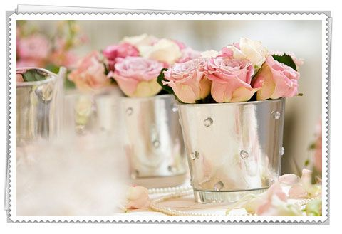 We will be putting pink roses on the table... Any table container for pink roses would be amazing (12 tables will used so whatever you can spare)