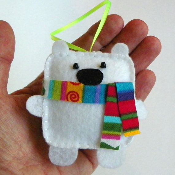 Mr. Polar Bear is ready for winter with his little scarf, he is the perfect addition to your ornament collection. He is 3 dimensional and has just as much personality as he does cuteness! He measures approximately 3 1/4 x 3 1/4 and is about 3/4 thick. He has been designed and completely hand made from start to finish by me. His eyes are glass beads and his scarf is flannel. He is gently weighted and stuffed to hang perfectly from his 3  ribbon. The pattern for these adorable bears will soon…