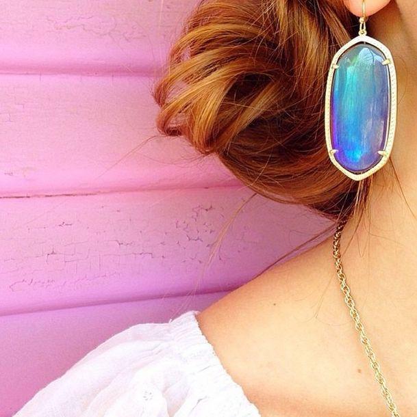 iridescent statement earrings.