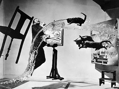"NO CGI Effects, pure film: ""At the end of his shoot with artist Salvador Dali — a session that took six hours and 28 throws (of water, a chair, and three cats), ""my assistants and I were wet, dirty and near complete exhaustion,"" photographer Philippe Halsman reported. The resulting image, with a leaping Dali in midair amid the madness, is a portrait as kinetic and surreal as artist's own work."""