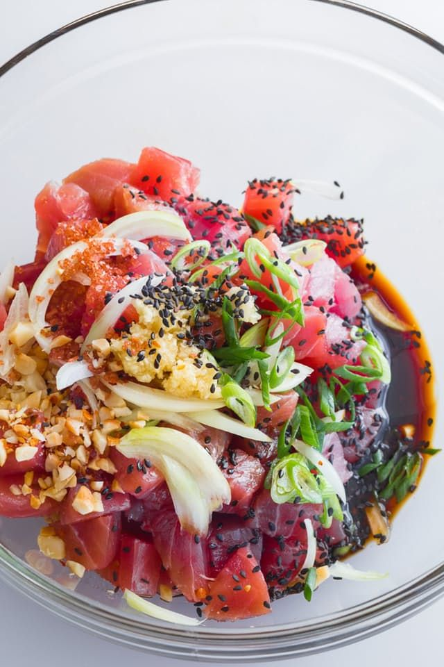 In Hawaii, poke, a salad of marinated uncooked tuna, can be found in pretty much every situation where food is present. I've seen it on fancy hotel buffets next to the seafood bar, in the deli section of grocery stores, and on the table by the tub at family potlucks and birthday parties. Here's the thing: Poke is pretty simple to make. All the work for this recipe happens when you're grocery shopping because the ingredients are what really matter.