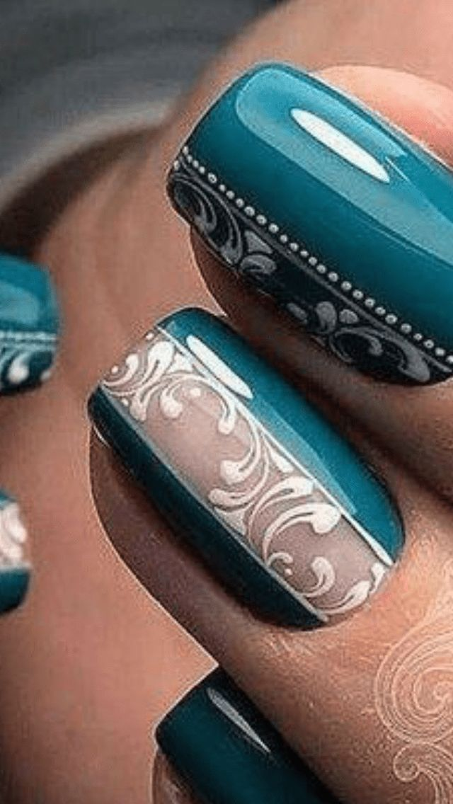 This is very intricate free hand nail detailing so Im posting it only as mere inspiration. However, you can use the same idea using negative space down the middle and use water decals or stamping t…