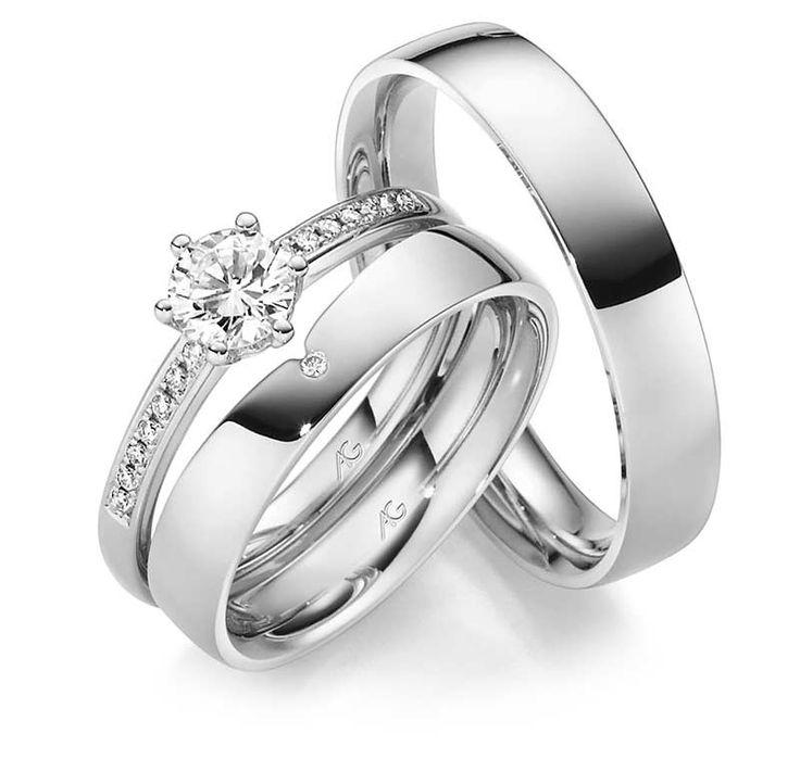 Verlobungsring mit schlichtem Ehering als vorsteckring. Passender herrenring