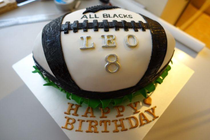 All Blacks rugby shape cake