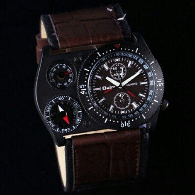 Oulm 4094M Multifunction Watch (Jam Tangan Multifungsi)  Harga Rp 245.000  Spesifikasi: - Brand: Oulm. - Grade: Original. - Tahan air: 3 ATM. - Panjang case: 5,5 cm. - Lebar case: 3,8 cm. - Tebal case: 1,2 cm. - Bahan case: Alloy. - Panjang tali: 23 cm. - Lebar tali: 3,7 cm. - Bahan tali: Leather. - Tipe clasp: Buckle. - Display: Analog. - Mesin: Quartz. - Tachymeter: Aktif. - Termometer: Aktif. - Kompas: Aktif. - Luminous atau glow in the dark: Pada jarum jam dan menit.