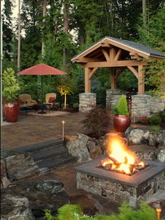 Custom Fire Art in Missoula, MT - great hardscape, firepit, and log constructed patio.  This is awesome!  I want this in my back yard!