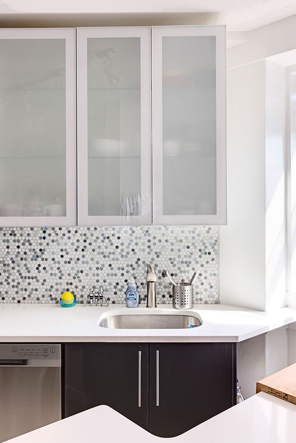 Intricate hex backsplash with tints of blue add texture to this IKEA kitchen remodel in Brooklyn