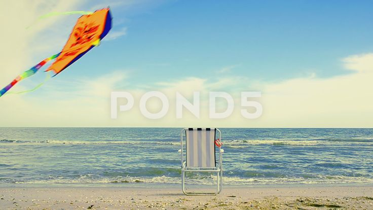 Video footage. Pond5.com. Chaise lounge on the beach; the sea and a kite.   #beach #time #background #ball #holiday #kite #word #sea #flying #sand #collection #shell #star #sun #lifebuoy #sky #fish #sunlight #decoration #chair #flop #shore #sunglasses #tropical #mesh #elements #umbrella #coral #title #sunshine #shape #season #rays #flipflop #realistic #flip #colorful #seashore #lounge #nature #vacation #editable #starfish #ocean #chaise lounge #color #day #summer  #Video #footage #stock…