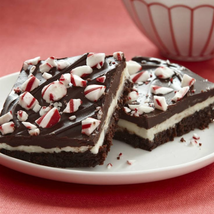 An extravagant dessert of a fudgy brownie layered with peppermint frosting and a rich chocolate glaze is the perfect addition to a holiday gift exchange.