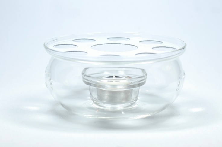 Small Glass Warmer. Perfect size for a 3-4 cup tea pot.  Place a tea light in the bottom of the warmer and place the tea pot filled with hot tea on the grid.  Your tea will stay warm as long as the tea light is burning.